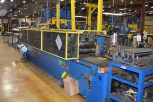 Heavy duty roll former with tooling specially designed and built by Isaiah Industries.