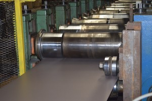Continuous coil-fed ClickLock production line ensures precise, consistent panel formation for installation ease and wind resistance.